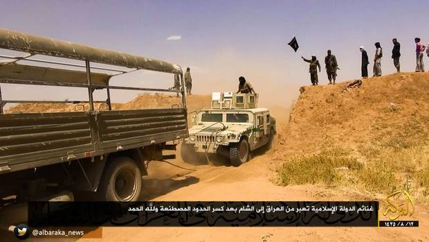 An image from and Islamic State video showing the breach of the Syrian border with Iraq.