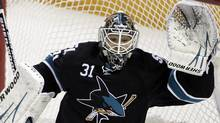 San Jose Sharks goalie Antti Niemi (31) blocks a shot against the Vancouver Canucks. (AP Photo/Paul Sakuma) (Paul Sakuma)
