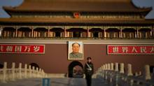 Sunday morning in Beijing at Tiananmen square china January 6, 2013 with a large portrait Mao Zedong. (John Lehmann/The Globe and Mail)