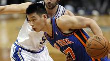 New York Knicks guard Jeremy Lin drives past MInnesota Timberwolves guard Ricky Rubio during the first half in Minneapolis, Feb. 11, 2012. (Eric Miller/Reuters/Eric Miller/Reuters)