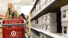 Retailers will feel the pressure through 2014 as Target and other rivals continue their incursion into the Canadian market. (Chris Young For The Globe and Mail)