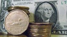 Canadian dollars shown with U.S dollar (Ryan Remio/THE CANADIAN PRE)