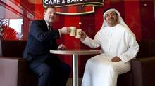 Sheikh Abdullah Bin Zayed Al Nahyan UAE's Minister of Foreign Affairs, right, has coffee while meeting with Canada's Foreign Minister John Baird at the Tim Hortons at Abu Dhabi Mall in Abu Dhabi on April 2, 2013. (Christopher Pike/The National)