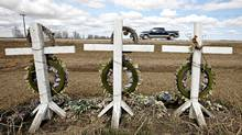 A roadside memorial stands along highway 63 near Grassland Alberta on May 2, 2012, where three people where killed in an accident along the dangerous highway to Fort McMurray. (Jason Franson for The Globe and Mail)