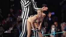 Robin Thicke, left, and Miley Cyrus perform at the MTV Video Music Awards on Sunday, Aug. 25, 2013, at the Barclays Center in the Brooklyn borough of New York. (Scott Gries/AP)