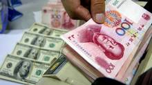 Chinese renminbi and U.S. dollars: retail forex investors are jumping in. (CHINA NEWSPHOTO/REUTERS)