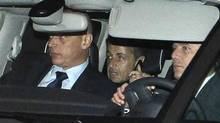 Former French president Nicolas Sarkozy, middle, leaves the courthouse in Bordeaux, France, Thursday. (Bob Edme/AP)