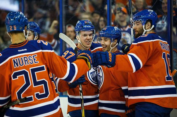 At 20 years old, the Oilers' Connor McDavid, centre, is the youngest player in the league to wear the captain's C.