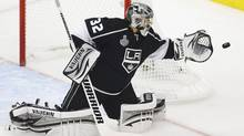 Los Angeles Kings goalie Jonathan Quick makes a save against the New Jersey Devils during the first peri od in Game 6 of the NHL Stanley Cup hockey final in Los Angeles, June 11, 2012. (DANNY MOLOSHOK/REUTERS)