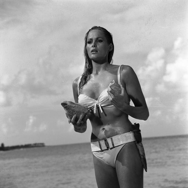 When Ursula Andress emerged from the sea with a dagger strapped to her bikini in 1962's Dr. No, she made the Bond girl an instant icon.