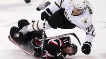 Dallas Stars Tom Wandell (top) trips over Ottawa Senators Daniel Alfredsson during the first period of their NHL hockey game in Ottawa November 24, 2010. REUTERS/Chris Wattie (CHRIS WATTIE)