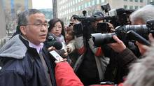 "Weizhen Tang talks to reporters while on a lunch break during a sentencing hearing in Toronto on Jan. 9, 2013. The Ontario Securities Commission has filed new allegations against Mr. Tang, who called himself a ""Chinese Warren Buffett"" while raising $50-million from investors. (J.P. Moczulski for The Globe and Mail)"