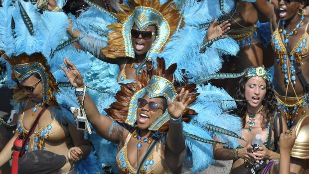 Revellers take part in the annual Scotiabank Caribbean Carnival parade in Toronto, August 4, 2012. (J.P. MOCZULSKI For The Globe and Mail)