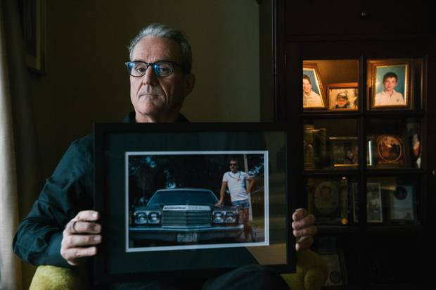 John Brady poses for a portrait at his home in Toronto on Nov. 2, 2017, with a favourite photo of his late brother, Conor. The photo, he says, represents Conor in his prime, when he was proud, healthy and confident, and is how John would like to remember him.