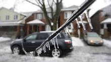 An ice caked power line hangs low over a road in Toronto on Dec. 22, 2013. (Fred Lum/The Globe and Mail)