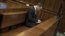 Olympic and Paralympic track star Oscar Pistorius attends his trial at the North Gauteng High Court in Pretoria on July 7, 2014. (IHSAAN HAFFEJEE/REUTERS)