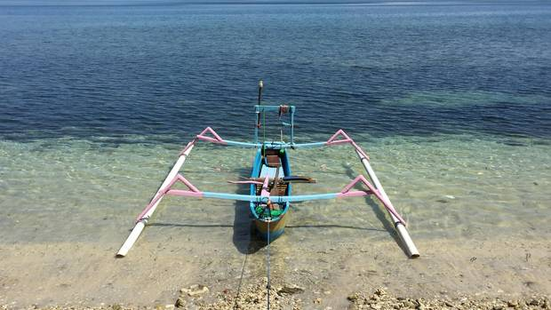A boat on a beach in the Gili Islands.