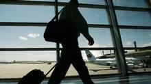 A passenger departs Calgary International Airport (TODD KOROL)