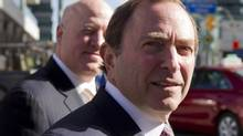 NHL Commissioner Gary Bettman (right) arrives with Assistant Commissioner Bill Daly for collective bargaining talks in Toronto on Wednesday October 16, 2012. (Chris Young/THE CANADIAN PRESS)