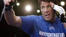 Chael Sonnen lands a punch during an open workout for UFC 148 in Las Vegas on Thursday, July 5, 2012. (John Locher/THE CANADIAN PRESS)