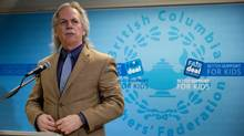 B.C. Teachers Federation president Jim Iker prepares to give a statement during a news conference in Vancouver, February 4, 2014. (DARRYL DYCK For The Globe and Mail)