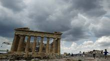 Tourists walk around the temple of the Parthenon at the archaeological site of the Acropolis hill in Athens June 16, 2011. (YIORGOS KARAHALIS/REUTERS)
