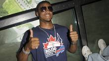In this June 12, 2009 file Buffalo Bills rookies defensive end Aaron Maybin was on a familiarization tour of Toronto during a visit to the city. After visiting the Hockey Hall of Fame, the he and another player toured and had lunch at the CN Tower where Aaron took some tentative steps onto the glass floor. On Thursday, Maybin was a guest of the Argos when they took on the Winnipeg Blue Bombers in CFL action at the Rogers Centre. (FRED LUM/THE GLOBE AND MAIL)