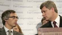 Prime Minister Stephen Harper asks a question of Industry Minister Tony Clement in this 2006 file photo (J.P. MOCZULSKI/J.P. Moczulski/Reuters)