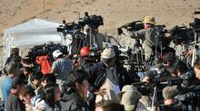 The crowded platform for the media at the San Jose mine. (AFP/Getty Images)