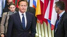 "British Prime Minister David Cameron leaves the EU Council building at the end of an EU summit in Brussels, early Sunday, Aug. 31, 2014. In a letter to North Atlantic Treaty Organization leaders last month, Prime Minister Cameron called the issue a ""personal priority"" and said he would like to see other countries sign on to a charter that could be modelled on Britain's own Armed Forces Covenant. (Geert Vanden Wijngaert/AP)"