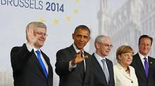 Canada's Prime Minister Stephen Harper, U.S. President Barack Obama, European Council President Herman Van Rompuy, Germany's Chancellor Angela Merkel and Britain's Prime Minister David Cameron pose for a group photo during a G7 leaders meeting at European Council headquarters in Brussels June 5, 2014. (YVES HERMAN/REUTERS)