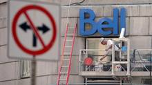 A construction worker works on a Bell building in Ottawa on Wednesday, June 26, 2013. (Sean Kilpatrick/THE CANADIAN PRESS)