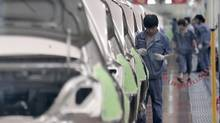 In this June 21, 2012 photo, a worker assembles an automobile at Chinese auto maker Geely Cixi Manufacture Base in Cixi, China. (Eugene Hoshiko/The Associated Press)