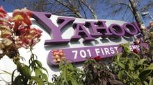 In this Jan. 4, 2012 file photo, the company logo is displayed at Yahoo headquarters in Sunnyvale, Calif. Yahoo Inc.last week announced it was laying off 2,000 employees as new CEO Scott Thompson sweeps out jobs that don't fit into his plans for turning around the beleaguered Internet company. The cuts announced Wednesday represent about 14 percent of the 14,100 workers employed by Yahoo. (Paul Sakuma/Paul Sakuma/AP)