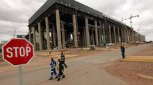Workers walk past the construction site of Medupi power station in Lephalele, South Africa, on April 11, 2013. (SIPHIWE SIBEKO/REUTERS)