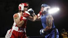 Liberal MP Justin Trudeau, left, engages in fisticuffs with Conservative Senator Patrick Brazeau in a charity match in Ottawa on Saturday night. (Chris Wattie/Reuters)
