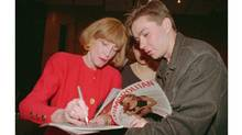 Helen Gurley Brown, editor-in-chief of Cosmopolitan magazine, signs an autograph for a Muscovite in April, 1994, during a presentation of the magazine's Russian edition. (Alexander Zemlianichenko/Associated Press)