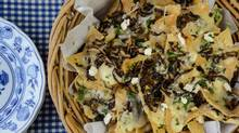 Nachos smothered in sauteed mushrooms and a variety of cheeses. (Tad Seaborn for The Globe and Mail)