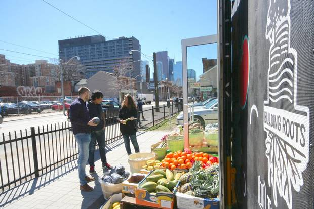 Darcy Higgins, left, Alex Chak and Lisa Kates created the Moss Park Market at the corner of Seaton Street and Queen Street E.