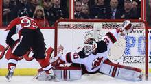 Ottawa Senators' Mika Zibanejad (L) scores the game-winning goal against New Jersey Devils' goalie Martin Brodeur during a shootout in their NHL game in Ottawa March 25, 2013. (BLAIR GABLE/REUTERS)