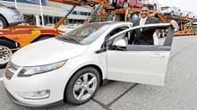 GM Canada president Kevin Williams with the first Volts to be delivered to Canadian dealers. (General Motors)