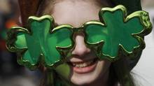 A reveller wears shamrock-shaped sunglasses during a St Patrick's Day parade near Trafalgar Square in central London March 14, 2010. (ANDREW WINNING/Andrew Winning/Reuters)