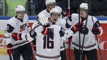 Team USA's Sean Kuraly celebrates his goal with teammates Alex Galchenyuk, Seth Jones, Mike Reilly and Riley Barber against Germany (MARK BLINCH/REUTERS)