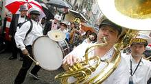 Despite heavy rains revelers keep the Mardi Gras weekend alive as they celebrated on the streets of the French Quarter in New Orleans. (SEAN GARDNER/REUTERS)