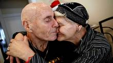Loucia Linkert, 60, snuggles and hugs her husband, Parkinson's sufferer Andrew, 72, at home in the kitchen of their apartment in Toronto on Dec. 8, 2011. (Deborah Baic/The Globe and Mail/Deborah Baic/The Globe and Mail)