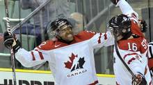 Devante Smith-Pelly and teammate Mark Stone