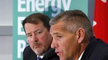 TransCanada CEO Russ Girling, right, and TransCanada president of energy and oil pipelines Alex Pourbaix announce the company is moving forward with the 1.1 million barrel-per-day Energy East Pipeline project at a news conference in Calgary, Alta., Thursday, Aug. 1, 2013. (Jeff McIntosh/THE CANADIAN PRESS)
