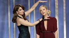 Tina Fey (left) and Amy Poehler at the Golden Globe awards. (Reuters)