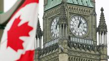The Canadian flag flies in front of the Peace Tower on Parliament Hill in Ottawa Sunday, September, 2005. (JONATHAN HAYWARD/Jonathan Hayward/CP)