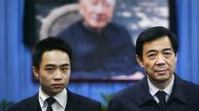 China's former Chongqing Municipality Communist Party Secretary Bo Xilai (R) and his son Bo Guagua stand in front of a picture of his father Bo Yibo, former vice-chairman of the Central Advisory Commission of the Communist Party of China, at a mourning hall in Beijing in this January 18, 2007 file photo. (Reuters/Reuters)
